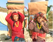Getting 159 blankets and mattresses to the people was no easy task as everything had to carried in. Both men and women worked to bring the goods to the earthquake survivors.