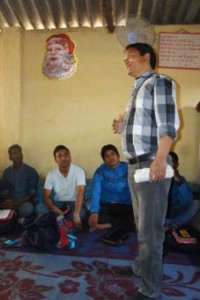 Rev. Indra B.M. of Nepalgunj works as a translator at a pastor's conference held in that Nepal city on March 23. These are a  new series of seminars designed for church leaders.