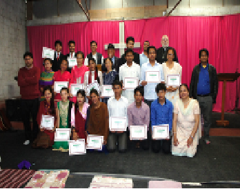 Students of Blessed Bible Institute of Chovar, Kathmandu, Nepal hold up their certificates of completion. There were 17 students that graduated on April 7.